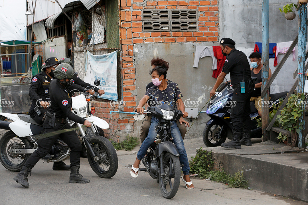 """Police patrols have been keeping residents in their homes in the Stung Meanchey I commune, one of seven areas designed as """"red zone"""" lockdown site. Videos shared on social media have shown police beating people with bamboo sticks to force them into their homes, April 21, 2021. CamboJA/ Panha Chhorpoan"""