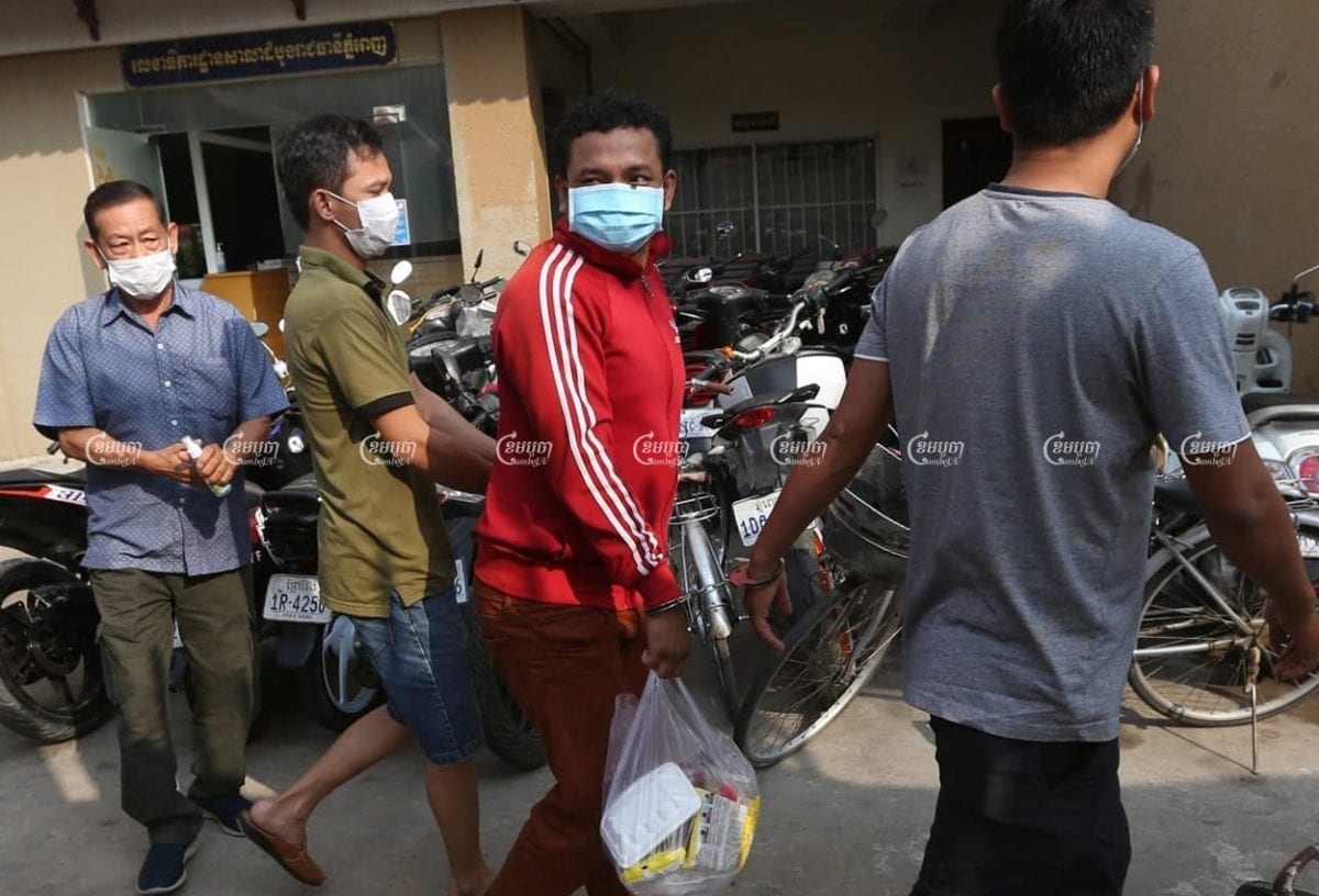 Three men arrive at Phnom Penh Municipal Court for questioning after they were arrested for allegedly violating the new COVID-19 law, April 7, 2021. CamboJA/ Pring Samrang