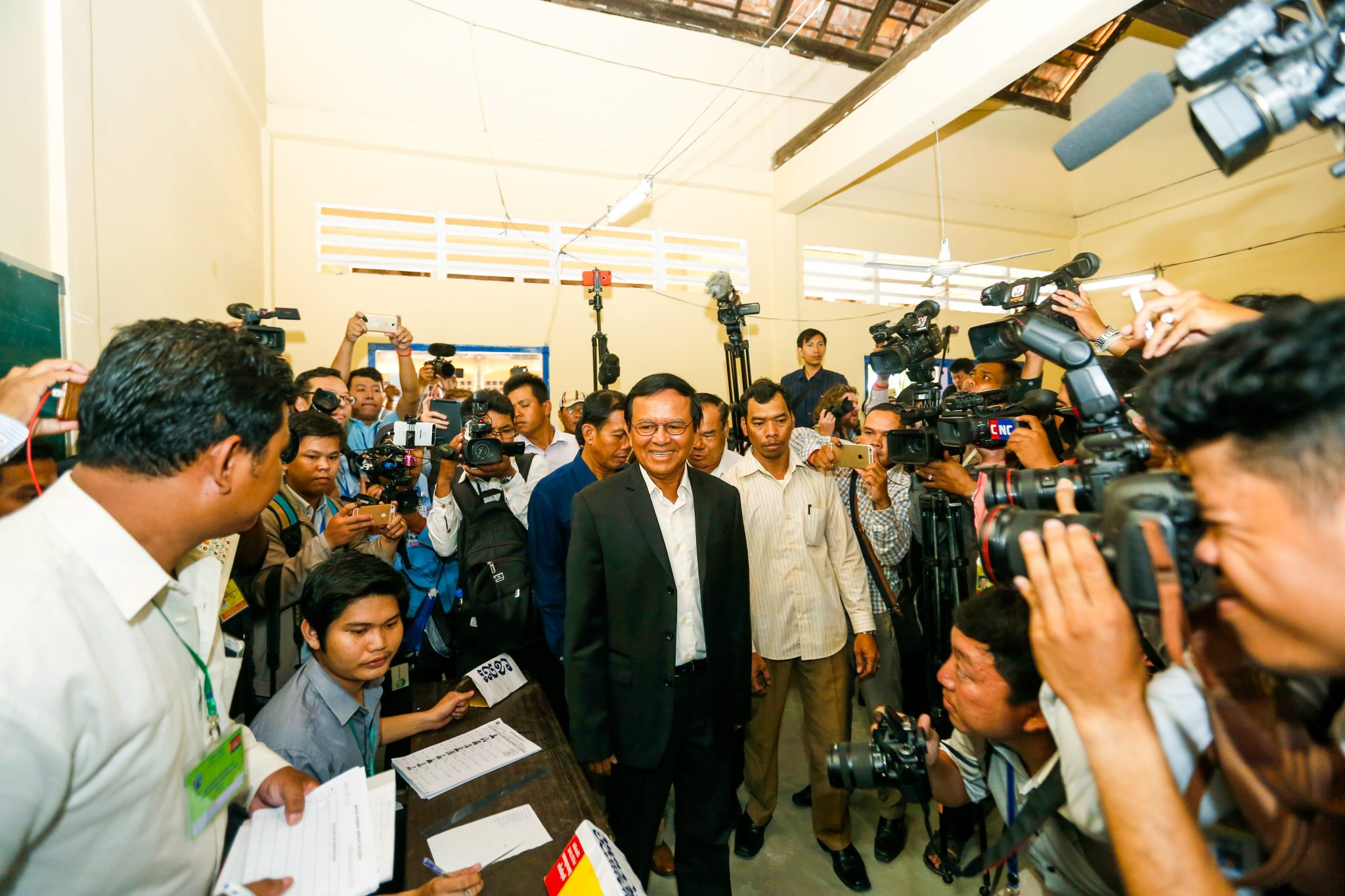 Kem Sokha, CNRP president, arrives at a polling center to vote during the 2017 commune election. CamboJA