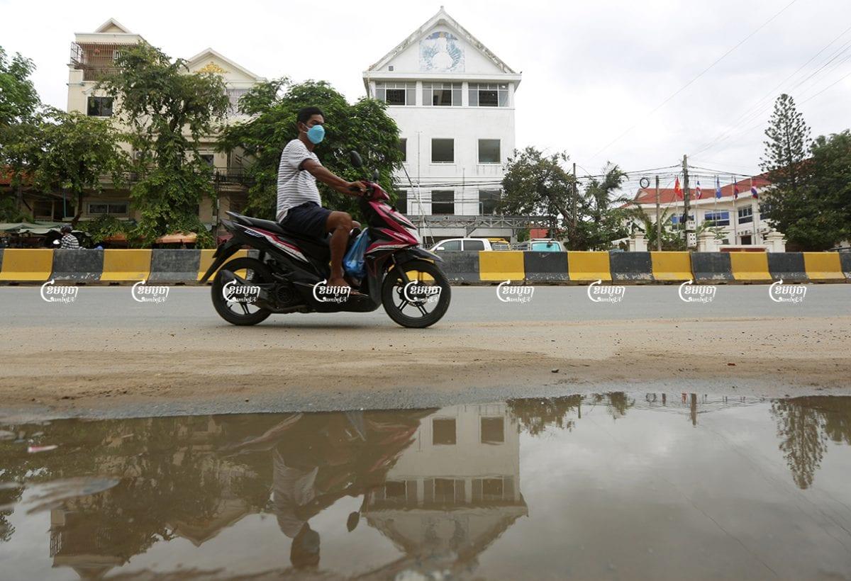 A man drives past the former CNRP headquarter in Phnom Penh, May 24, 2021. CamboJA/ Pring Samrang