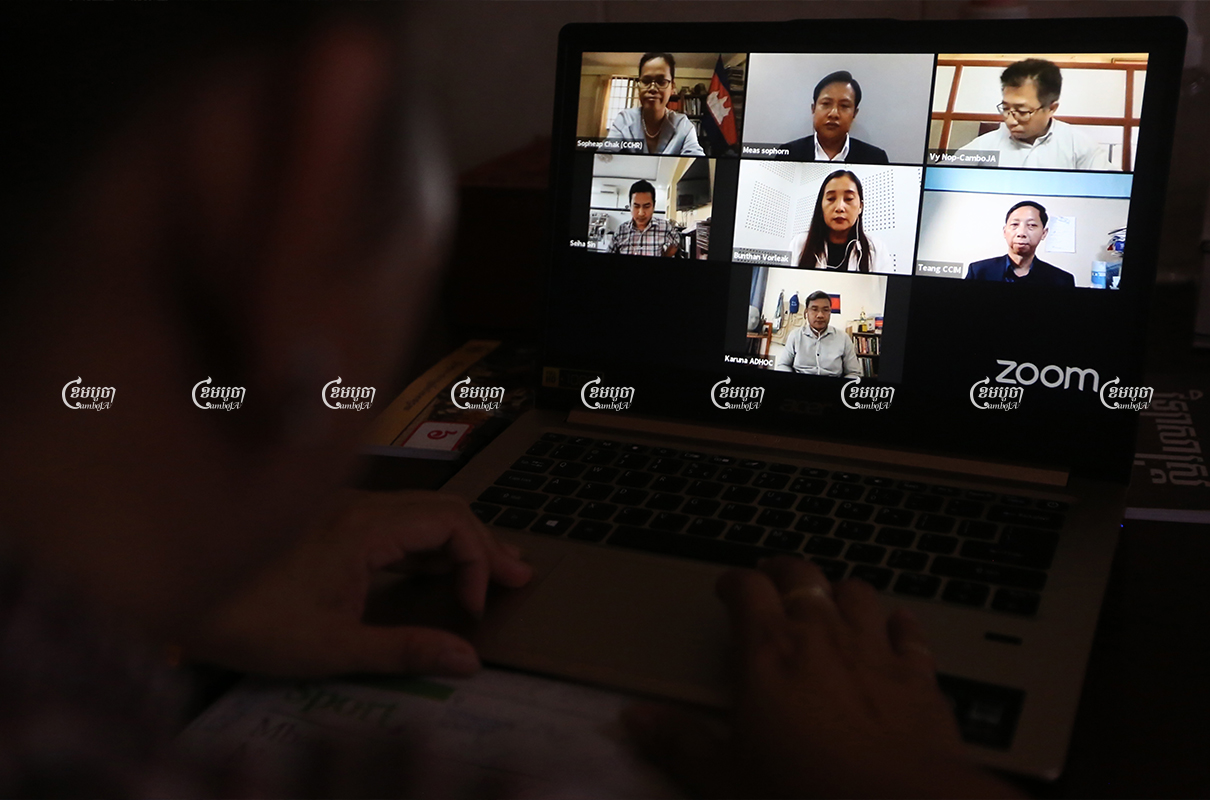 A woman watches the livestream of an online panel discussion over Zoom to commemorate World Press Freedom Day, May 3, 2021. CamboJA/ Pring Samrang