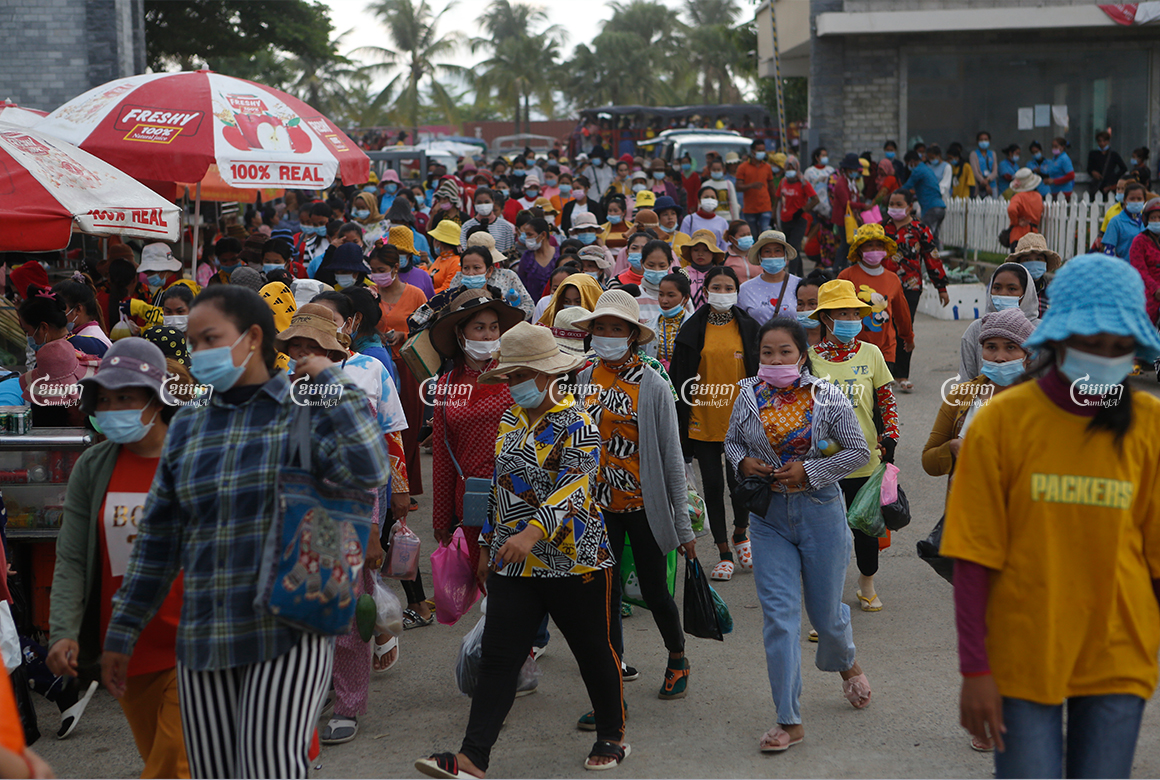 Garment workers leave a factory after finishing their day in the Kong Pisei district of Kampong Speu province on May 6, 2021. CamboJA/ Panha Chhorpoan