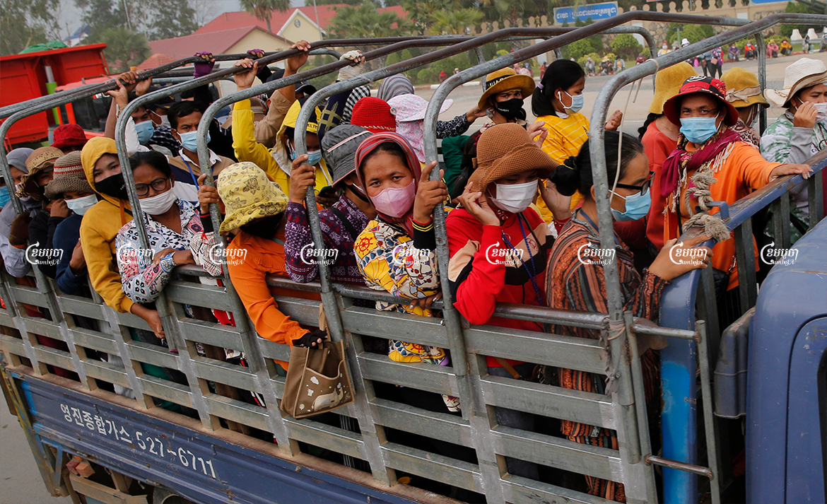 Garment workers leave a factory after finishing their work on the outskirts of Phnom Penh, May 6, 2021. CamboJA/ Panha Chhorpoan
