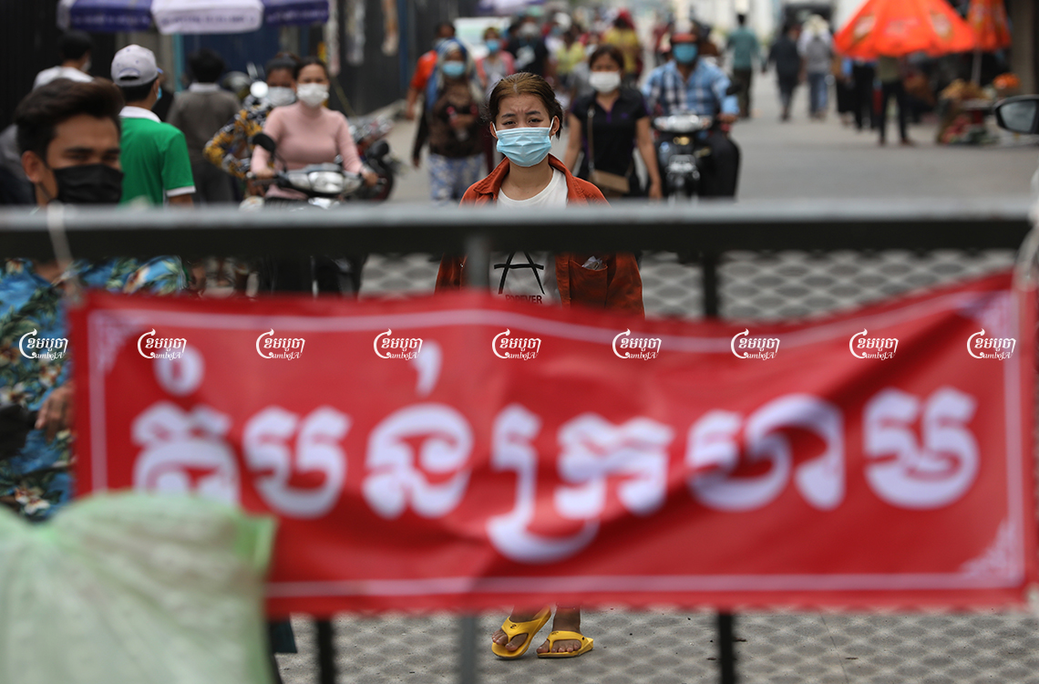 Garment workers leave after receiving a COVID-19 vaccination in a red zone in Choam Chao 1 commune, Pur Senchey District in Phnom Penh, May 12, 2021. CamboJA/ Pring Samrang