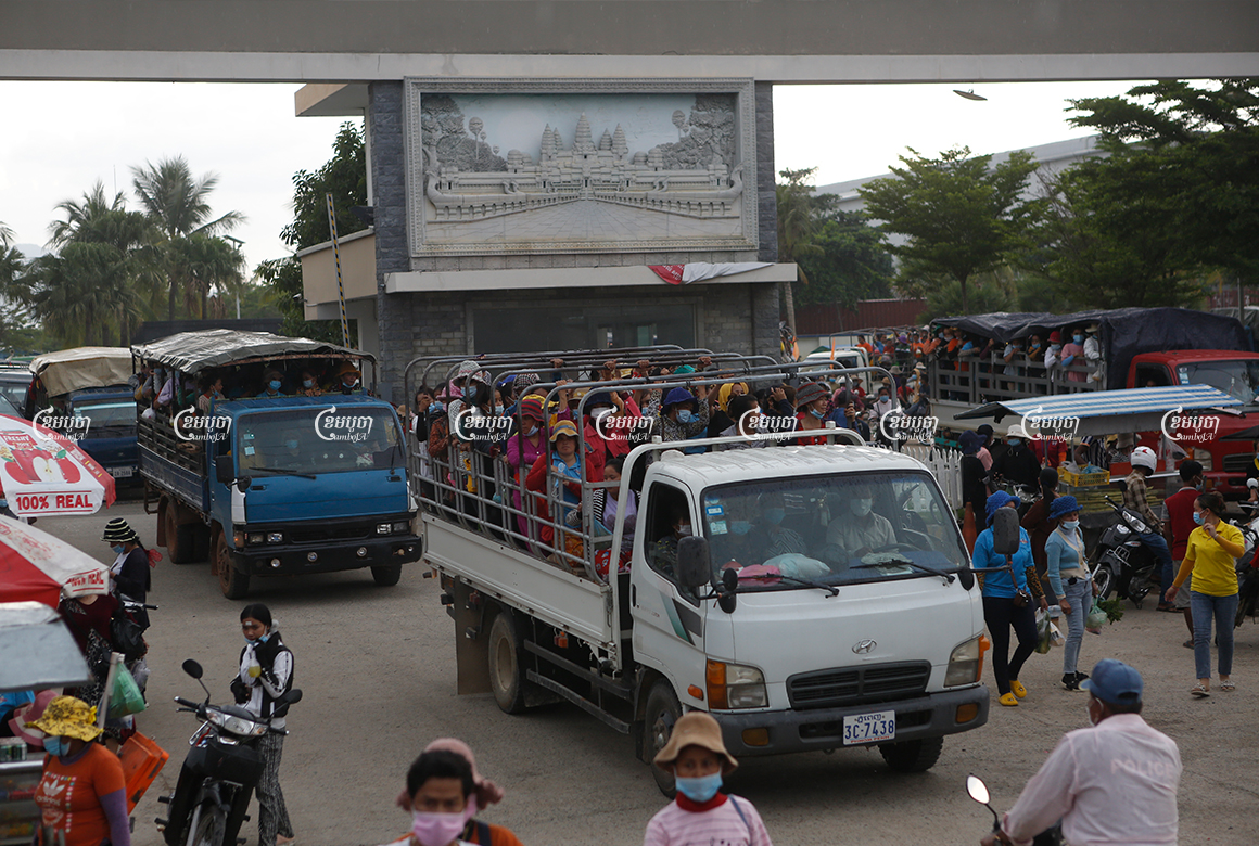 Garment workers ride on a crowded truck after finishing their shift at a factory in the Kong Pisei district of Kampong Speu province on May 6, 2021. CamboJA/ Panha Chhorpoan