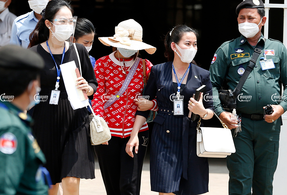 Lawyers and the mother of Mean Pich Rita leave Phnom Penh Municipal Court after signing the bail guarantee for her release, May 13, 2021. CamboJA/ Panha Chhorpoan
