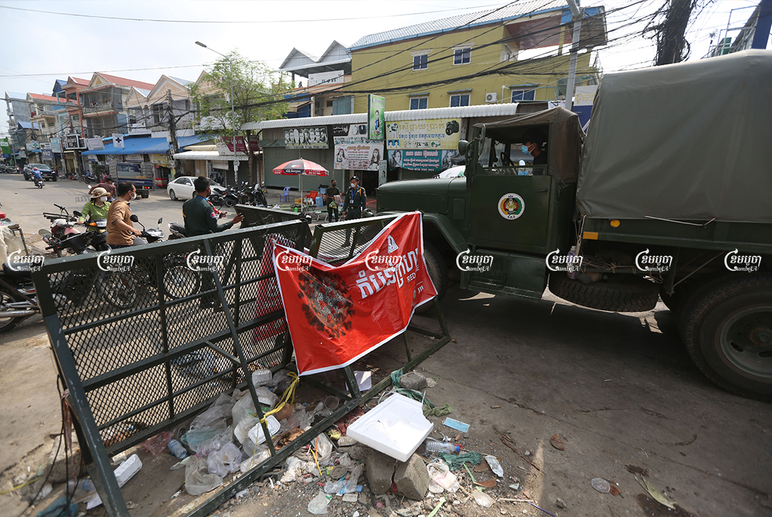 Military trucks bring food supplies for distribution to residents who live in a red zone in Stung Meanchey 3 commune in Phnom Penh, May 12, 2021. CamboJA/ Pring Samrang
