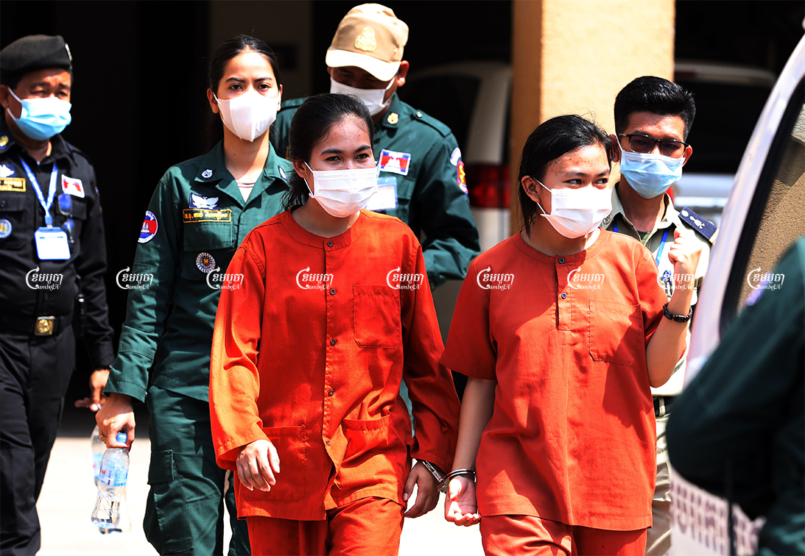 Mother Nature activists Phuon Keoreaksmey and Long Kunthea leave Phnom Penh Municipal Court after their verdicts, May 5, 2021. CamboJA/ Pring Samrang