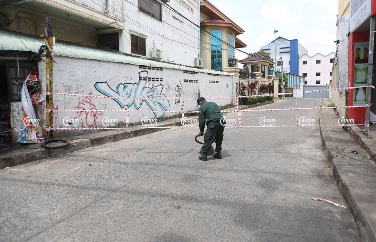 Police block a road leading into a red zone in Stung Meanchey I commune, April 29, 2021. CamboJA/ Pring Samrang