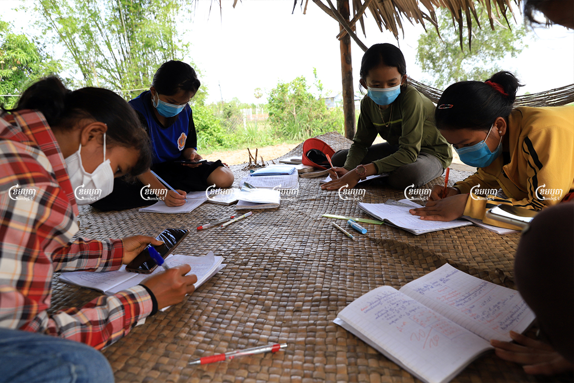 Students review lessons at home that their teacher sent via the Telegram messaging app in Krabey Real commune, Siem Reap province, May 7, 2021. CamboJA/ Panha Chhorpoan