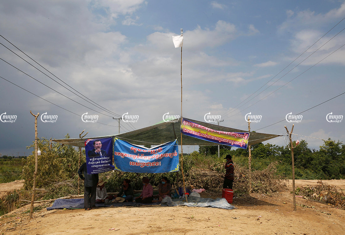 Villagers set up camp to block a street leading to a new airport construction site. The development is locked in a dispute with villagers in Kandal province's Kandal Stung district, May 17, 2021. CamboJA/ Panha Chhorpoan