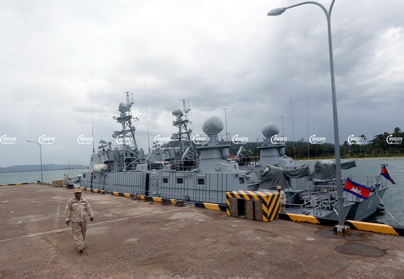 A naval officer walks near patrol boats at Ream Naval Base in Sihanoukville, Cambodia. Picture taken during a media trip organized by the government on July 26, 2019. CamboJA/ Pring Samrang