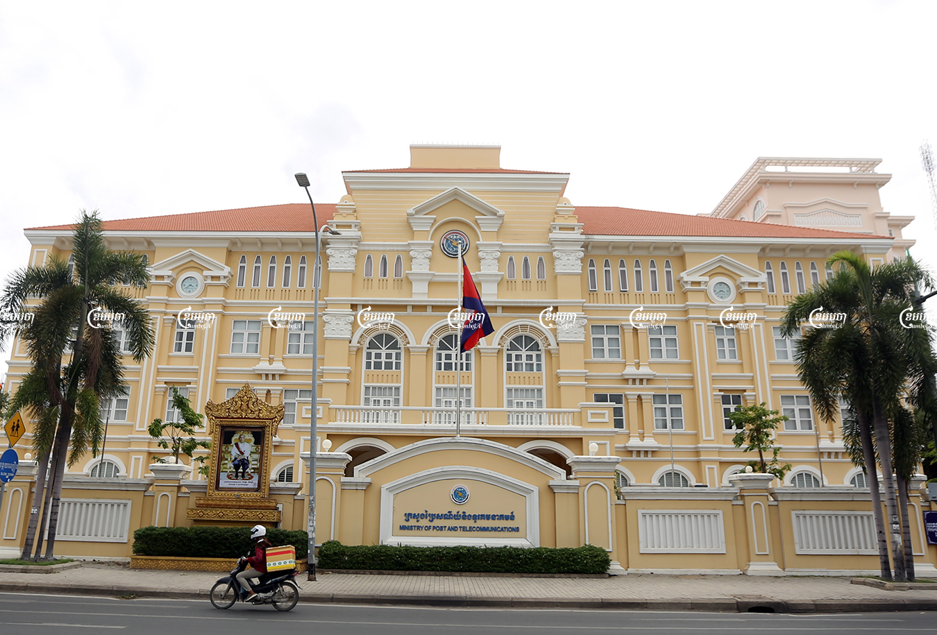 A person drives past the Ministry of Post and Telecommunications on Monivong Blvd, in Phnom Penh, June 7, 2021. CamboJA/ Pring Samrang