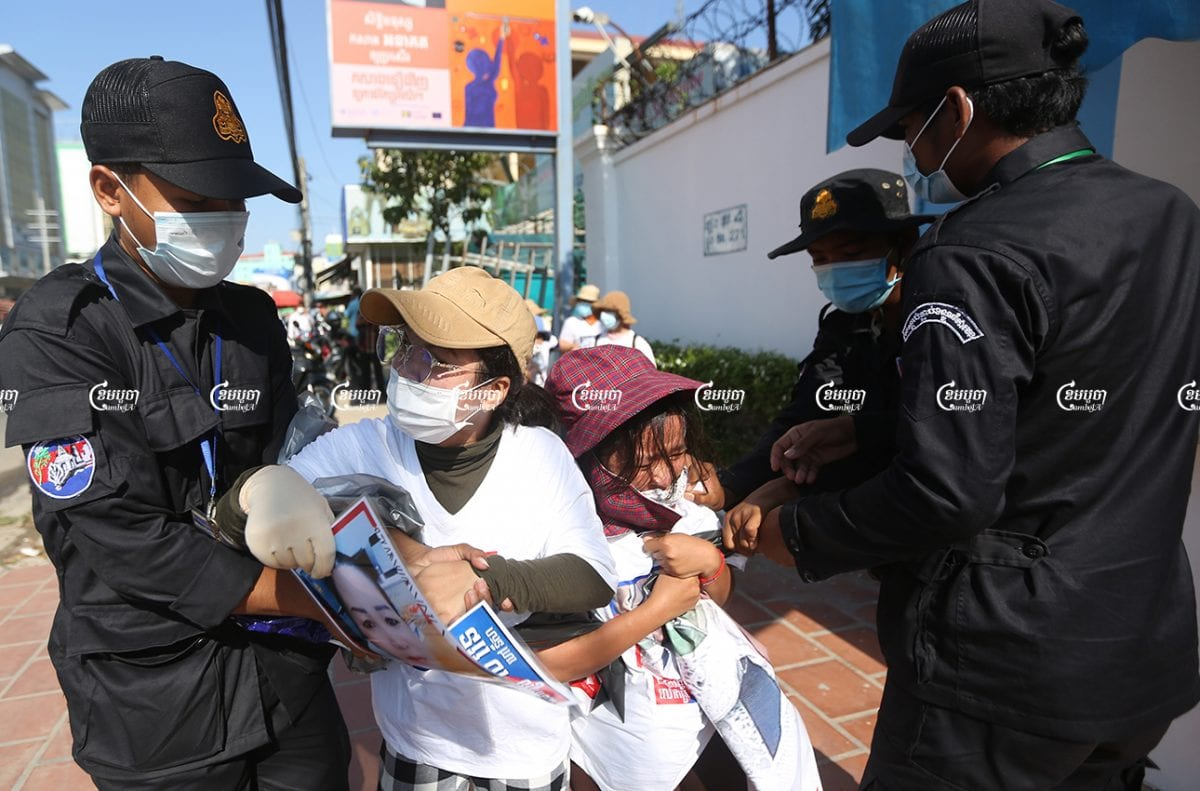 Authorities seized banners from the family members of activists from the forcibly dissolved CNRP as they submittes a petition to a UN office in Phnom Penh, June 4, 2021. CamboJA/ Pring Samrang