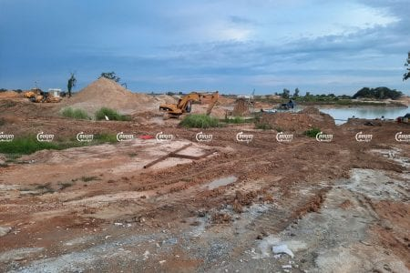 Company workers use excavators and bulldozers to prepare land for a new airport in Kandal province, June 15, 2021. CamboJA/ Panha Chhorpoan