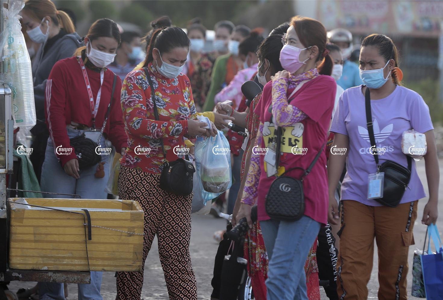 Garment workers arrive at their factory at Kakap II commune, Pur Senchey district in Phnom Penh, June 14, 2021. CamboJA/ Panha Chhorpoan