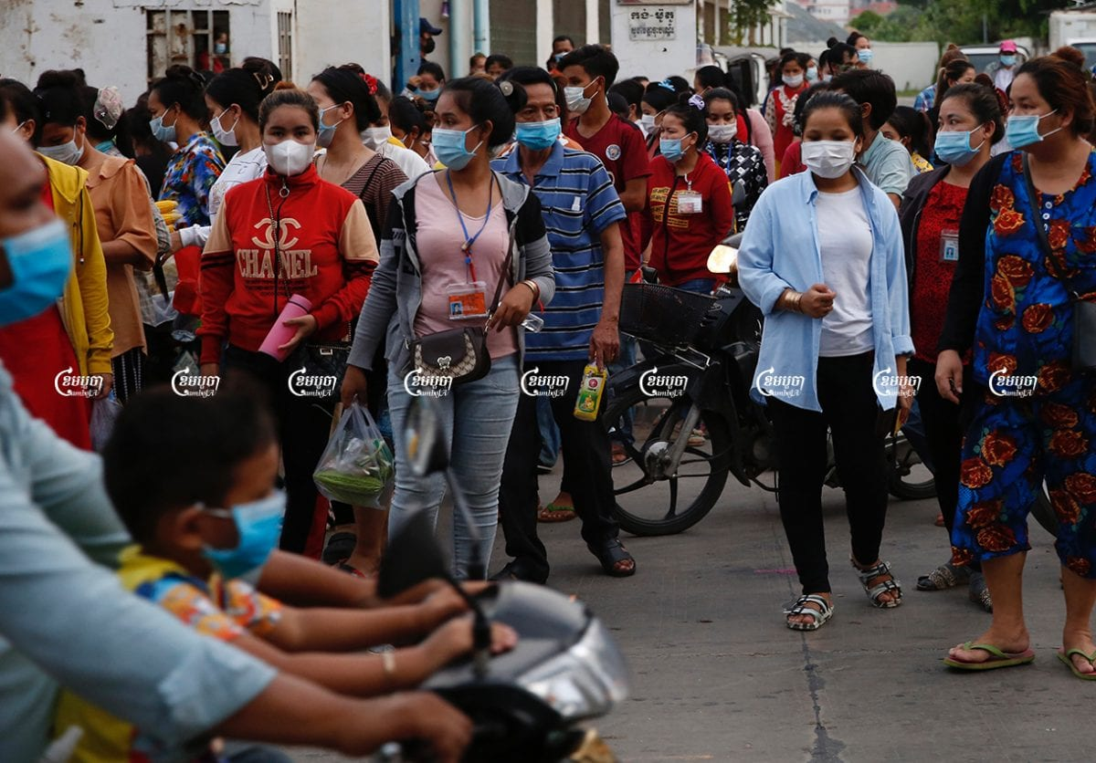 Garment workers leave a factory after finishing their work, in Phnom Penh, June 2, 2021. CamboJA/ Panha Chhorpoan