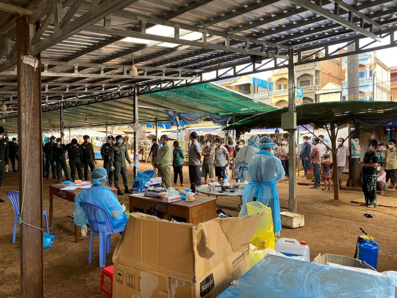 Health officials collect samples from people in Ratanakiri's Banlung Town. Photo taken from the provincial administration's Facebook page.