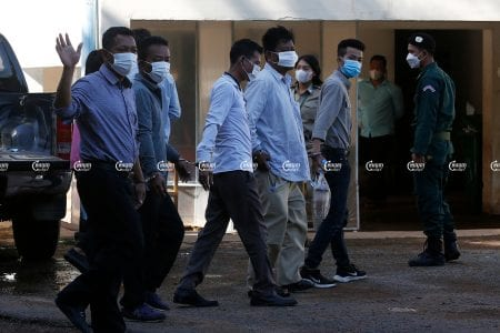 Journalists arrested for allegedly extorting an illegal cockfighting ring arrive at the Kandal Provincial Court for questioning, June 22, 2021. CamboJA/ Panha Chhorpoan