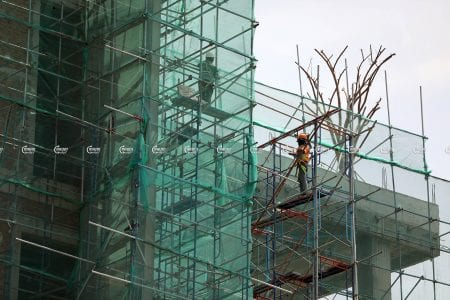 Laborers work at a construction site in Phnom Penh, picture taken on June 8, 2021. CamboJA/ Pring Samrang