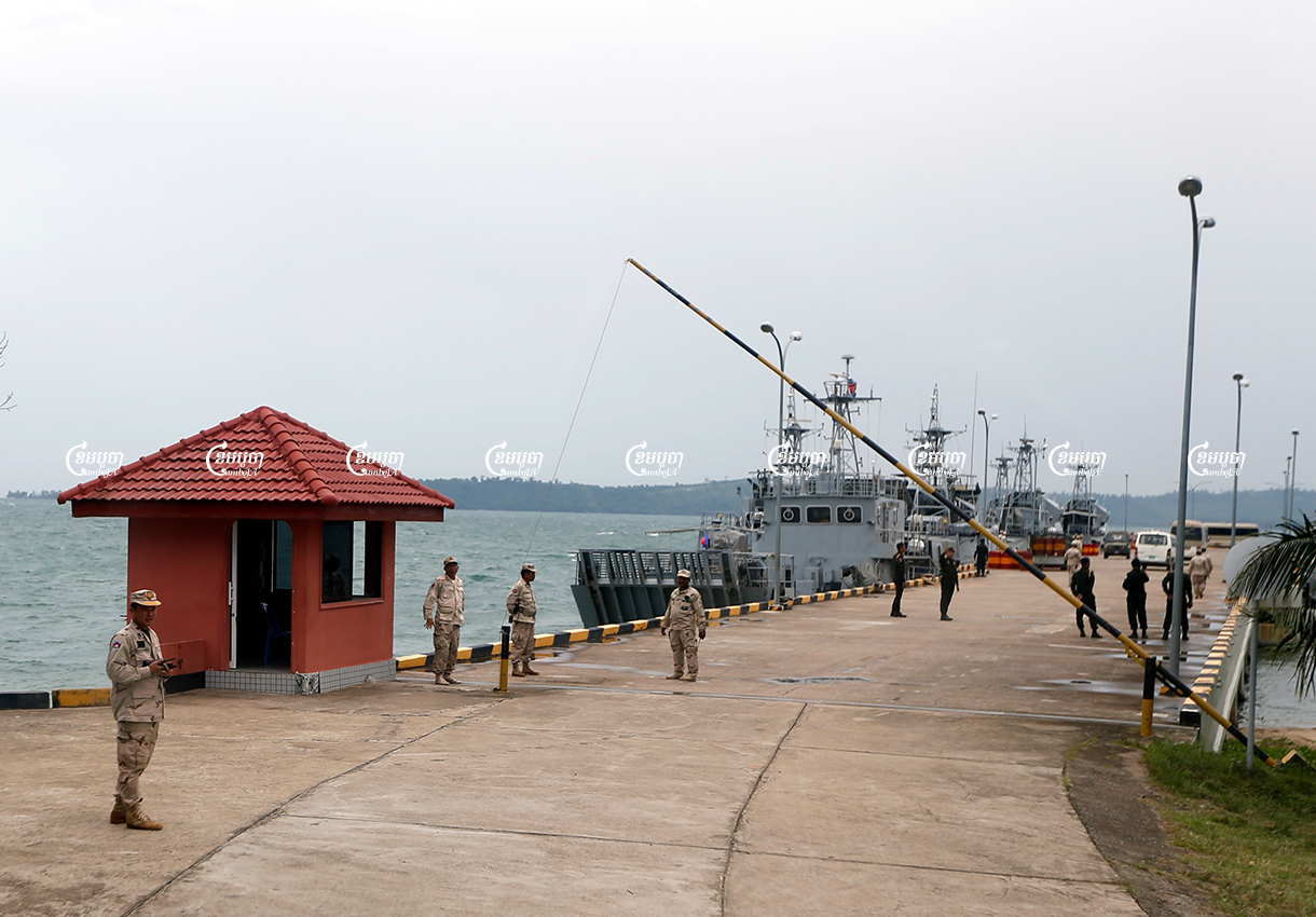 Naval officers stand guard near patrol boats at Ream Naval Base in Sihanoukville, Cambodia. Picture taken during a media trip organised by the government on July 26, 2019. CamboJA/ Pring Samrang