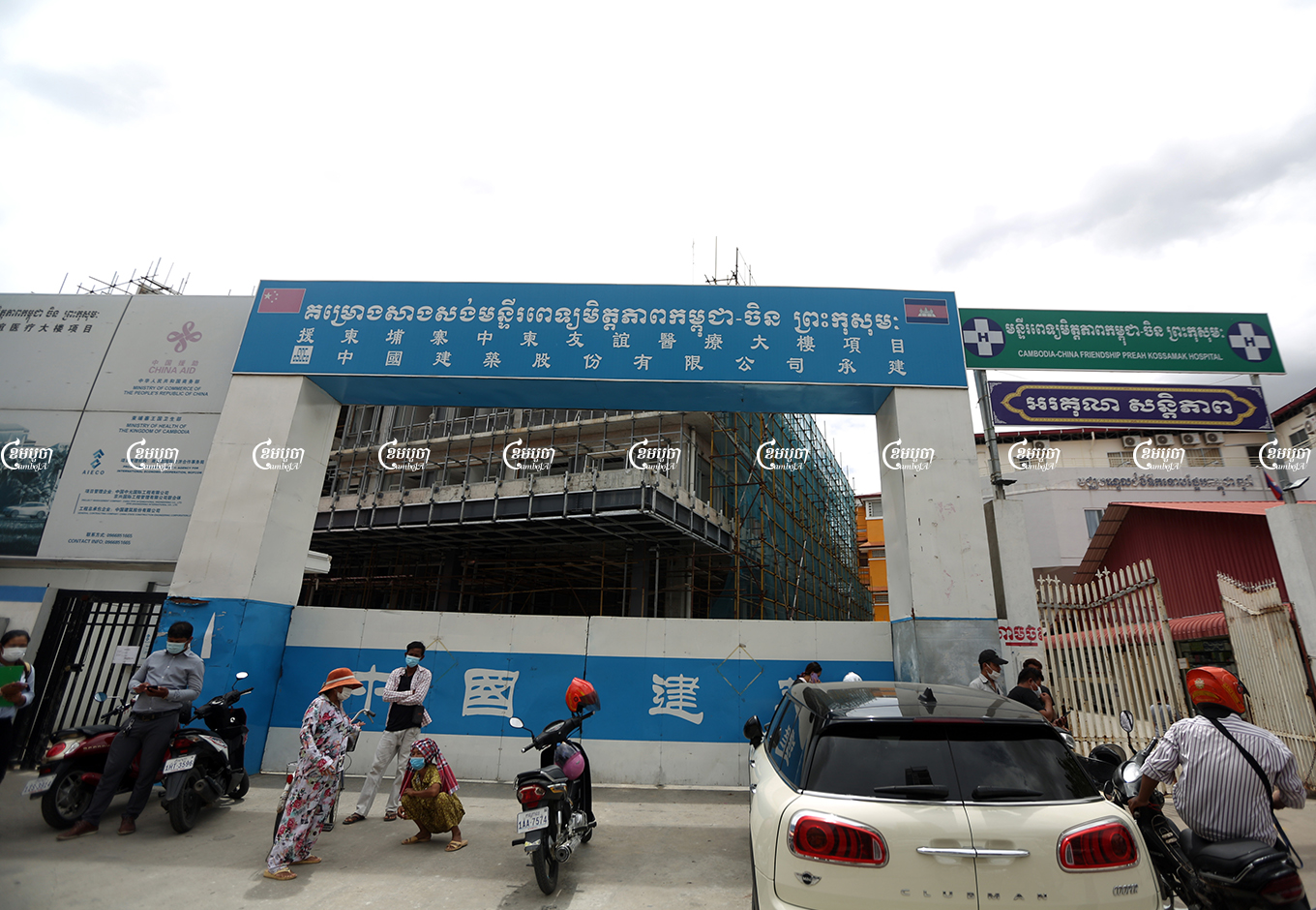 People stand in front of the entrance to the Cambodia-China Friendship Preah Kossamak Hospital in Phnom Penh, June 10, 2021. CamboJA/ Pring Samrang