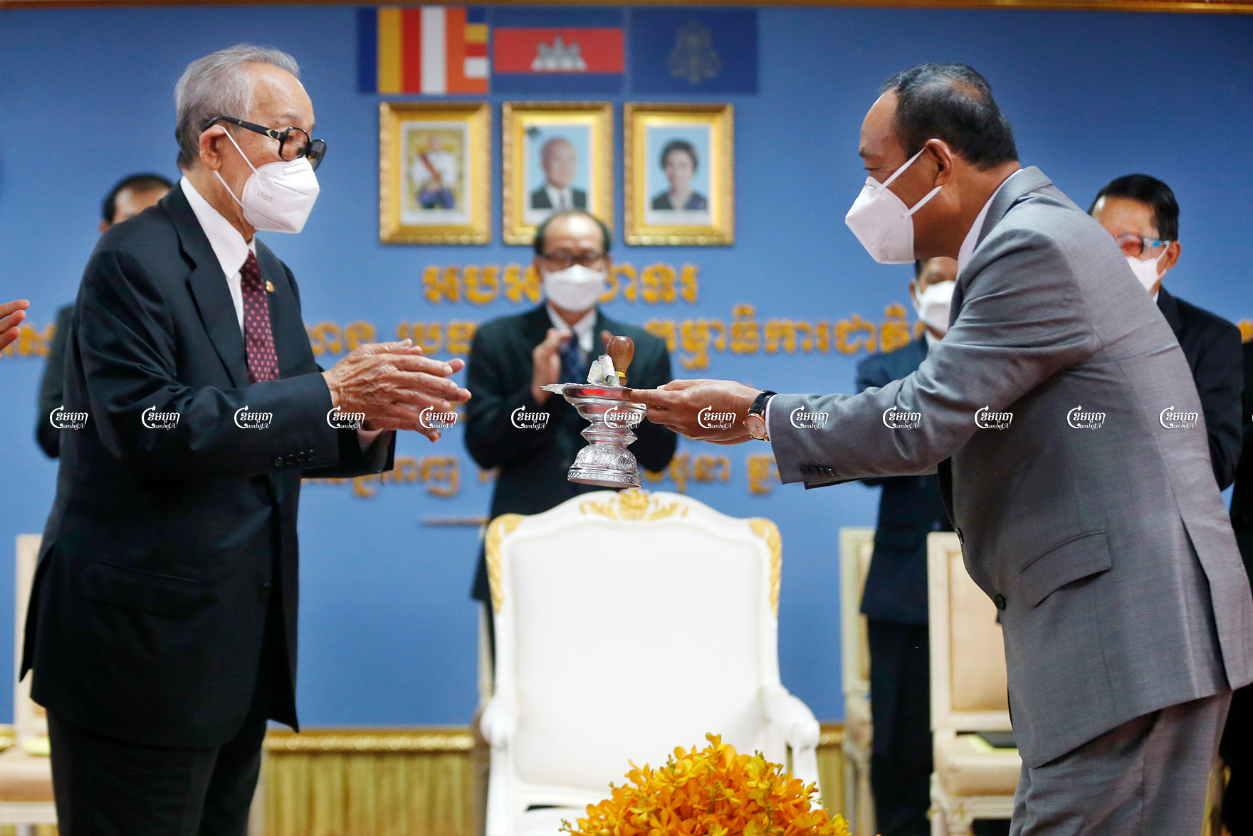 Prach Chan (R), the new chairman of the National Election Committee, receives the NEC seal from Minister of the Royal Palace Kong Sam Ol at a ceremony in Phnom Penh, June 30, 2021.CamboJA/ Panha Chhorpoan