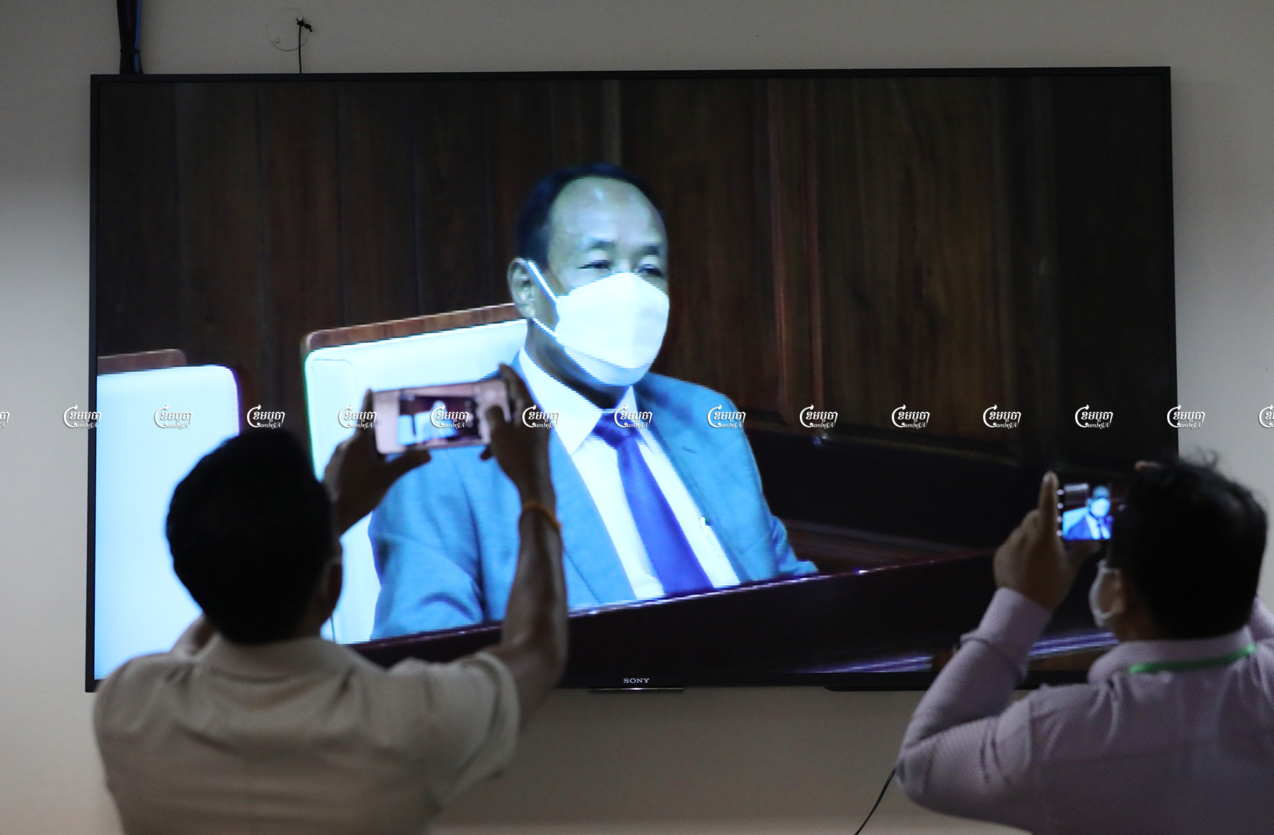 Prach Chan, the new chairman of the National Election Committee, is seen on live television at the National Assembly in Phnom Penh, June 24. CamboJA/ Pring Samrang