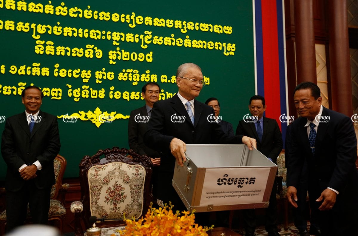 Sik Bun Hok, chairman NEC holds a lot drawing to determine the order of political party on ballot papers for the July 2018 election, in Phnom Penh, Picture taken on May 29, 2018. CamboJA/ Samrang Pring
