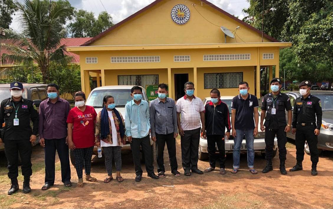 The journalists charged with extortion after taking photos in a private area of a timber warehouse late last week in Preah Vihear. Photo credited by The Association of Freedom for Cambodian Journalists