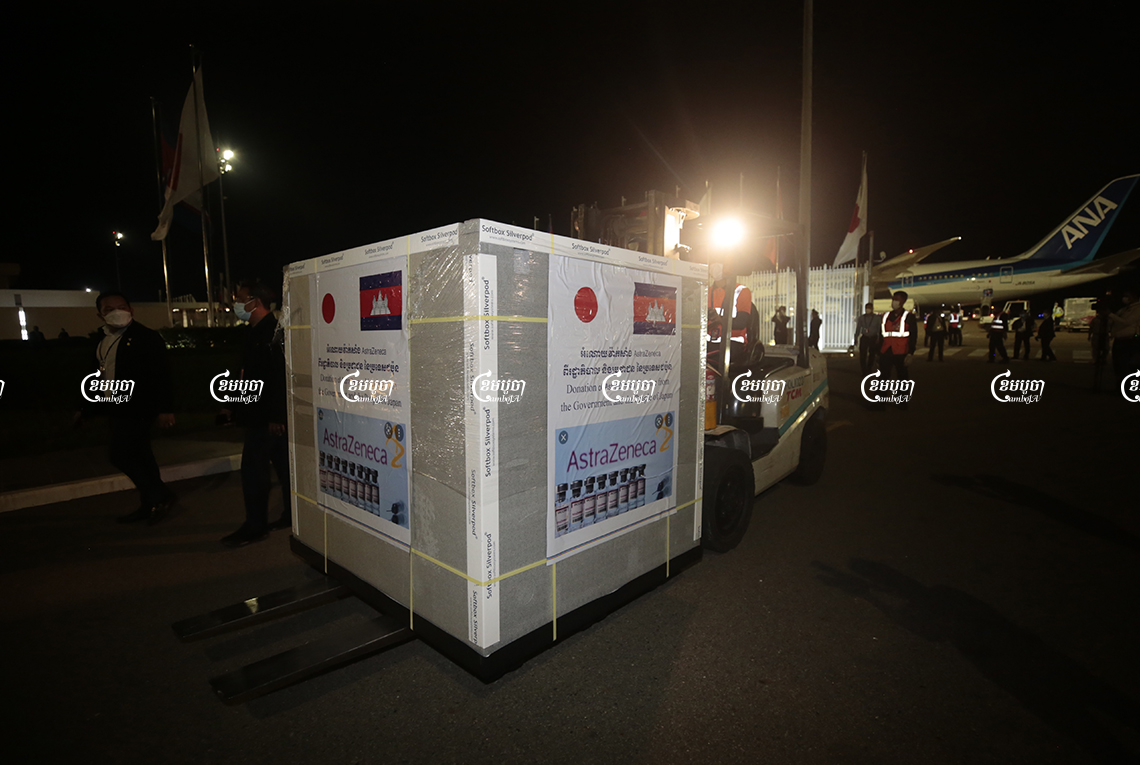 A box with 332,000 doses of AstraZeneca donated by Japan arrives at Phnom Penh International airport on Friday night, July 23, 2021. CamboJA/ Panha Chhorpoan