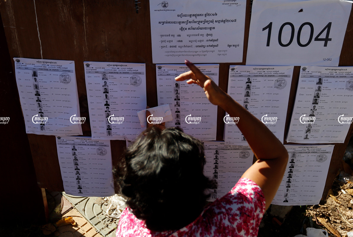 A woman searches for her name on a voting list during commune elections in Phnom Penh. Picture taken on June 4, 2017. CamboJA/ Pring Samrang