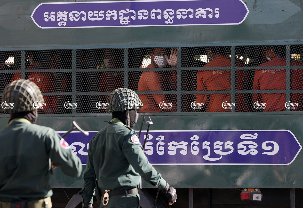 Activists with Khmer Thavrak and Khmer Student Intelligent League arrive at the Phnom Penh Municipal Court to join their hearing, July 27, 2021. CamboJA/ Pring Samrang