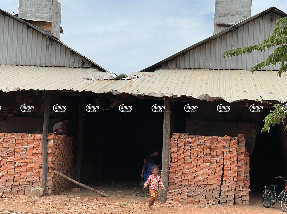 Children play at a brick kiln in Kandal province while their parents work making bricks, July 20. CamboJA/ Khuon Narim