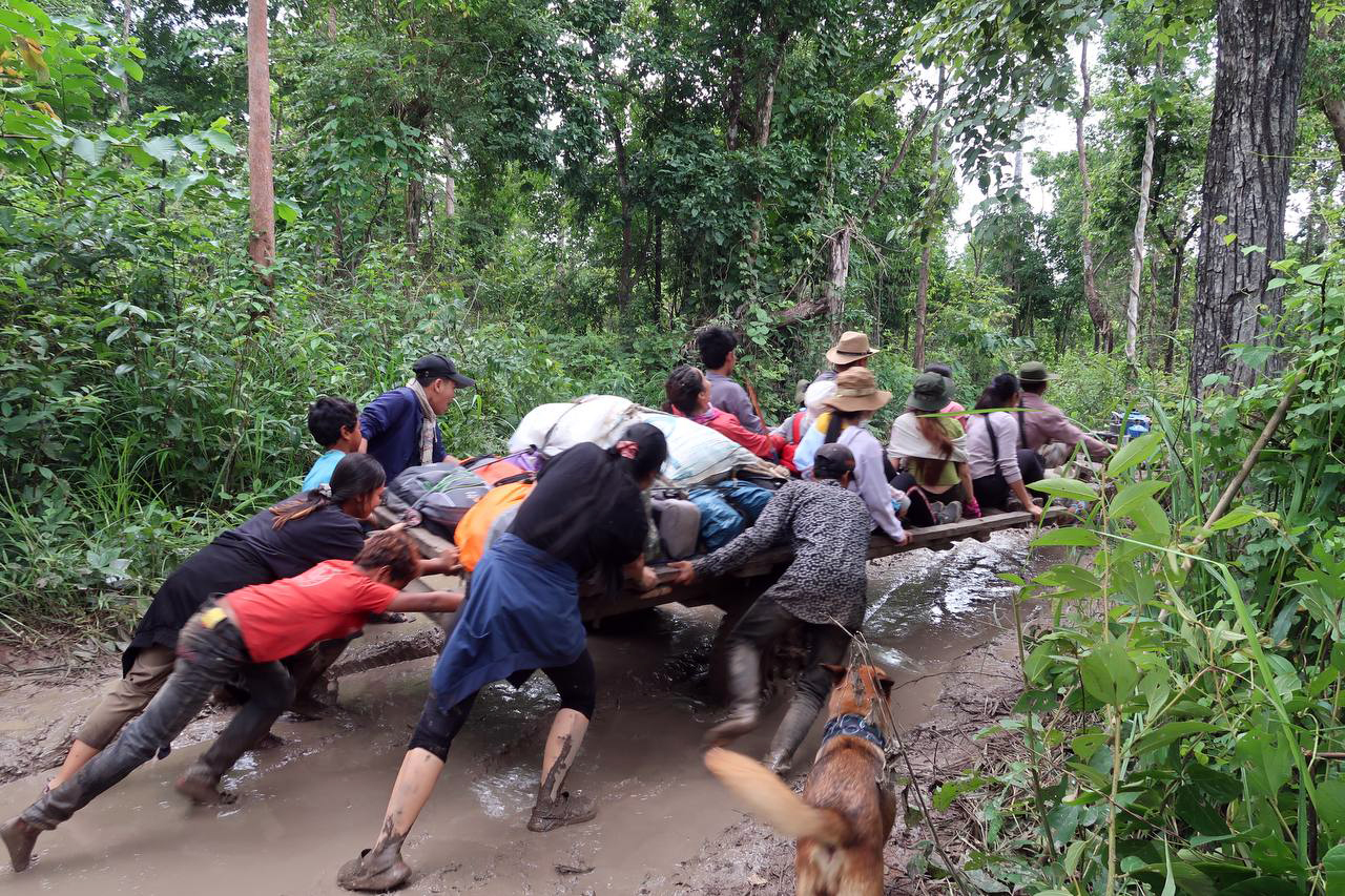 Tourists help push a tractor stuck in the mud while hiking in Khnong Phsar June 20,2021. Chen Phearun