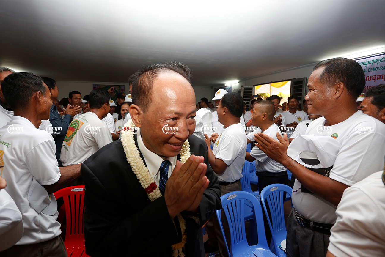 Mam Sonando, president of the Beehive Social Democratic Party, greets party members during a party congress in 2018. CamboAJ/ Panha Chhorpoan