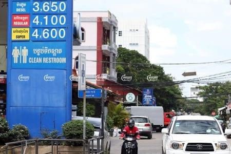 Motorists drive past a gasoline station in Phnom Penh, July 19, 2021. CamboJA/ Pring Samrang