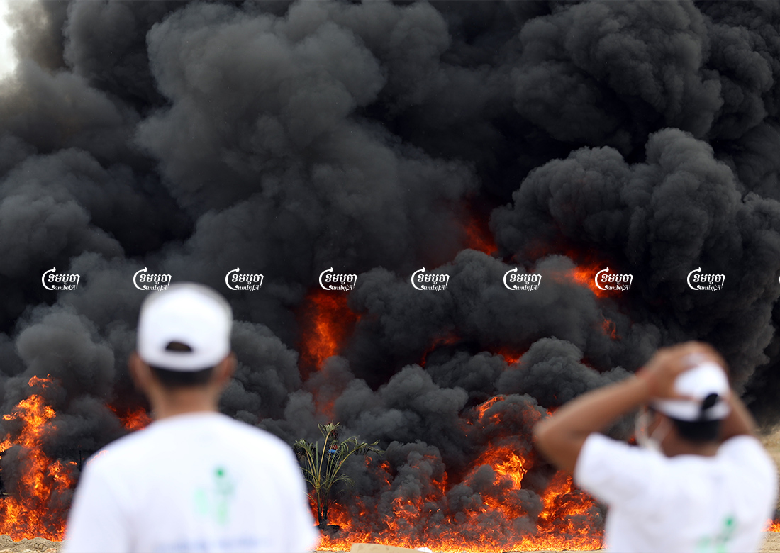 Officials look on as seized drugs are burned at a ceremony marking the International Day against Drug Abuse and Illicit Trafficking in Phnom Penh, July 19, 2021. CamboJA/ Pring Samrang