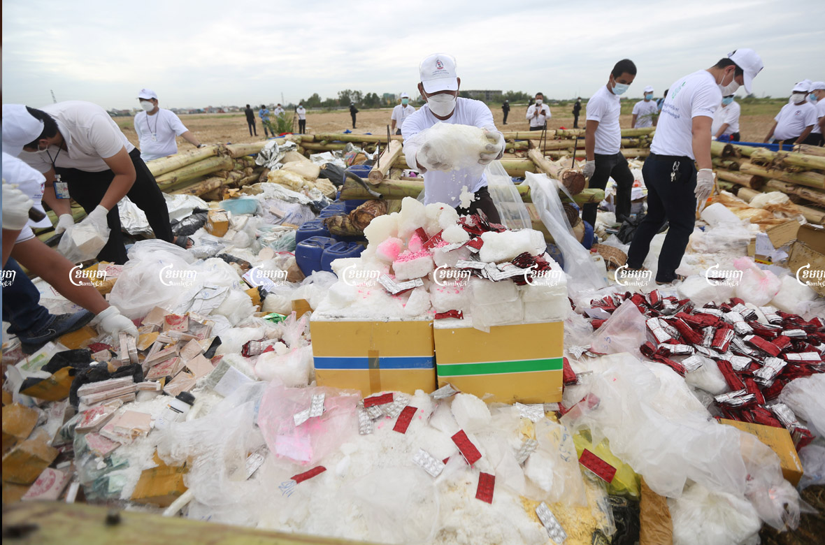 Officials prepare confiscated drugs for burning during a ceremony to mark the International Day against Drug Abuse and Illicit Trafficking in Phnom Penh, July 19, 2021. CamboJA/ Pring Samrang