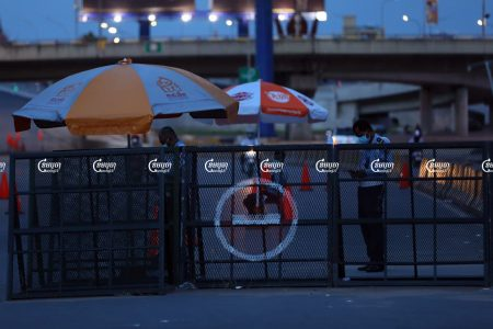 Police set up a barricade along a street during a lockdown in Phnom Penh, Picture taken on April 24, 2021. CamboJA/ Pring Samrang