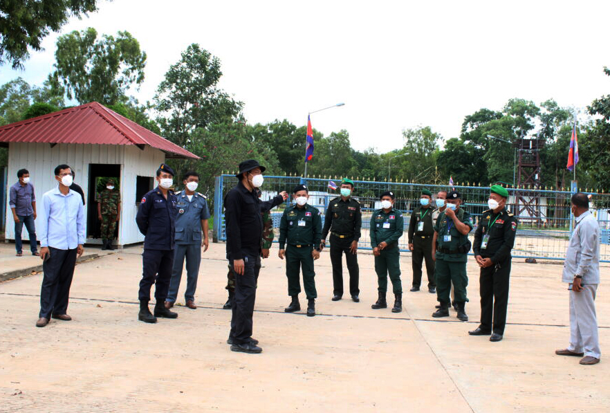 Oddar Meanchey provincial authorities inspect a closed Thai-Cambodian border checkpoint on July 30, 2021.