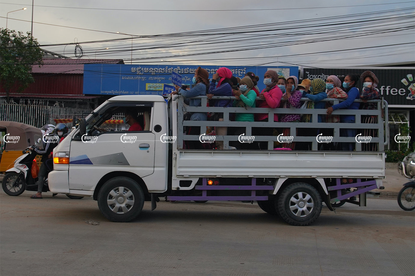 Garment workers travel by truck to factories in Phnom Penh. CamboJA/ Panha Chhorpoan