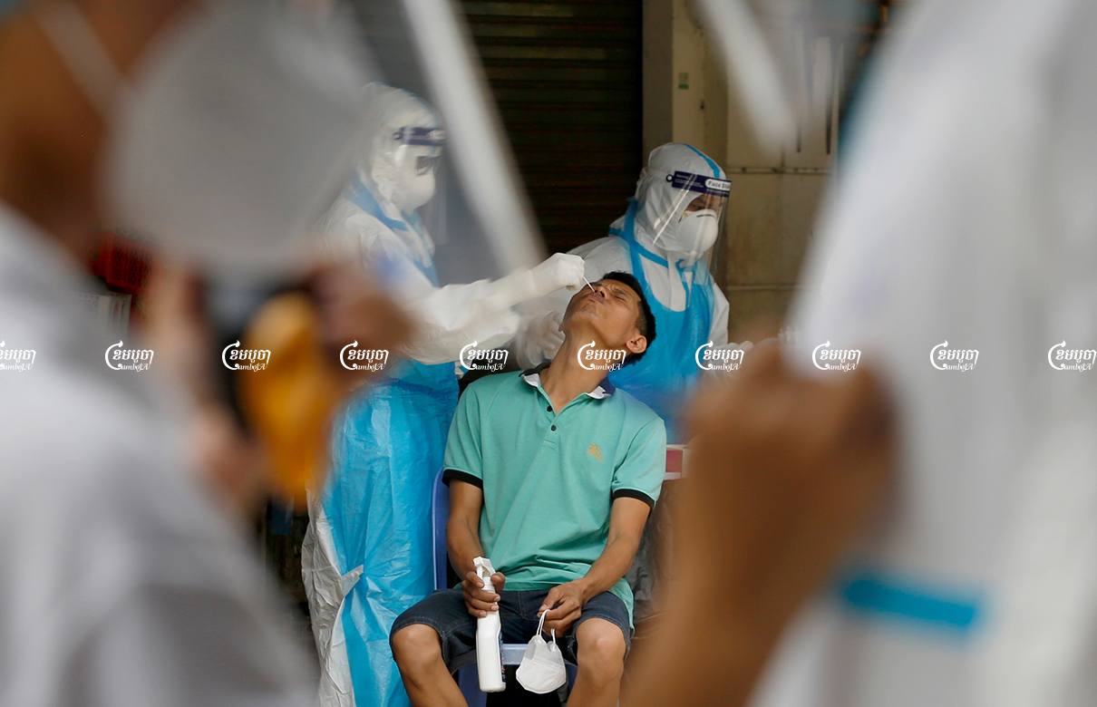 Health officials give Covid tests to residents in Phsar Touch village, Tuol Sangke 1 commune, Russei Keo district in Phnom Penh, which has recorded an outbreak of the Delta variant, August 2, 2021. CamboJA/ Panha Chhorpoan