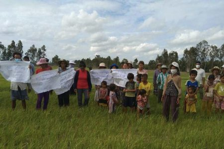 Villagers protesting on August 2 on farmland within the disputed boundary of a Svay Rieng canal restoration project. Supplied