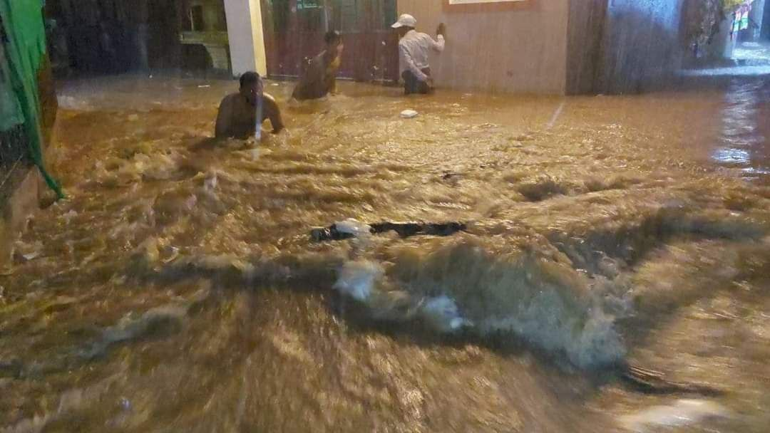 Residents of Muoy commune, Sihanoukville make their way through floodwaters, Picture taken on August 24. Supplied