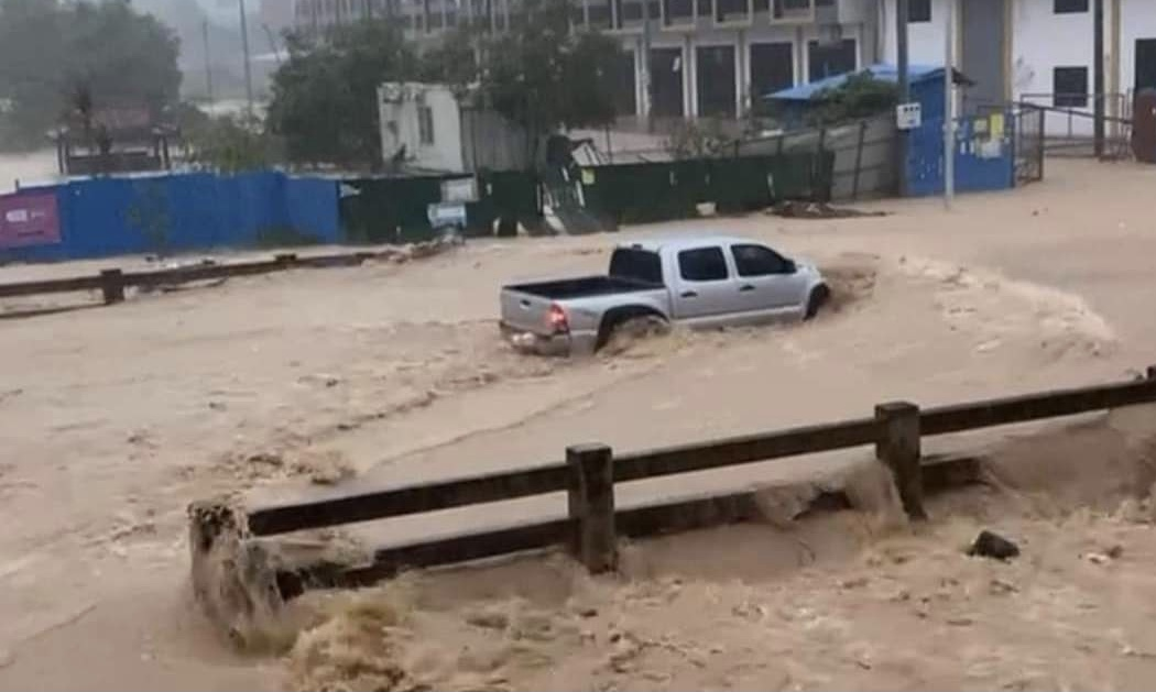 A truck drives through floodwaters in Sihanoukville. Picture taken on August 24. Supplied
