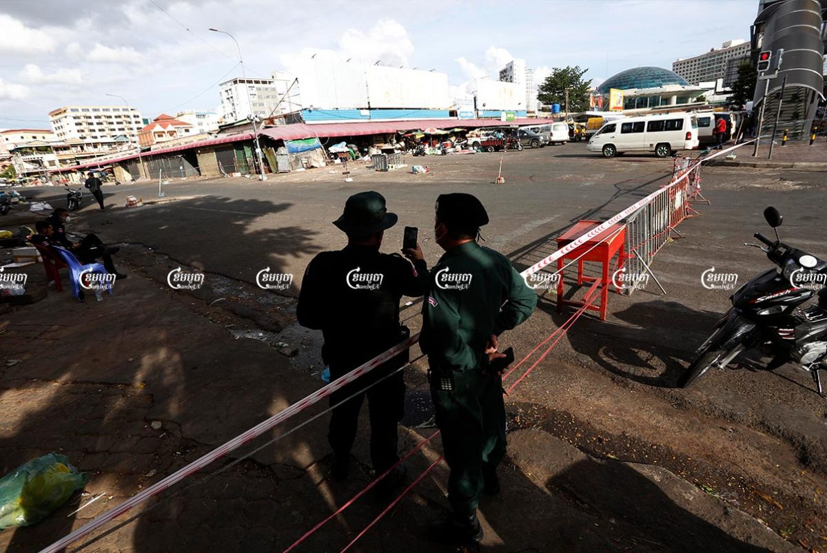 Police officers guard Doeumkor market in Tuol Kor district, which was closed down after a recent COVID-19 case was traced there, August 3, 2021. CamboJA/ Panha Chhorpoan