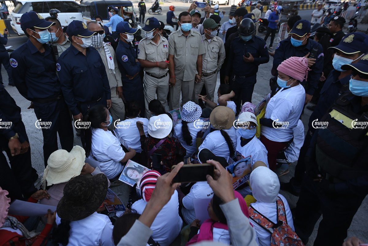 Relatives of imprisoned CNRP members are surrounded by authorities during a protest near the Municipal Court of Phnom Penh, Picture taken on February 18, 2021. CamboJA/ Pring Samrang