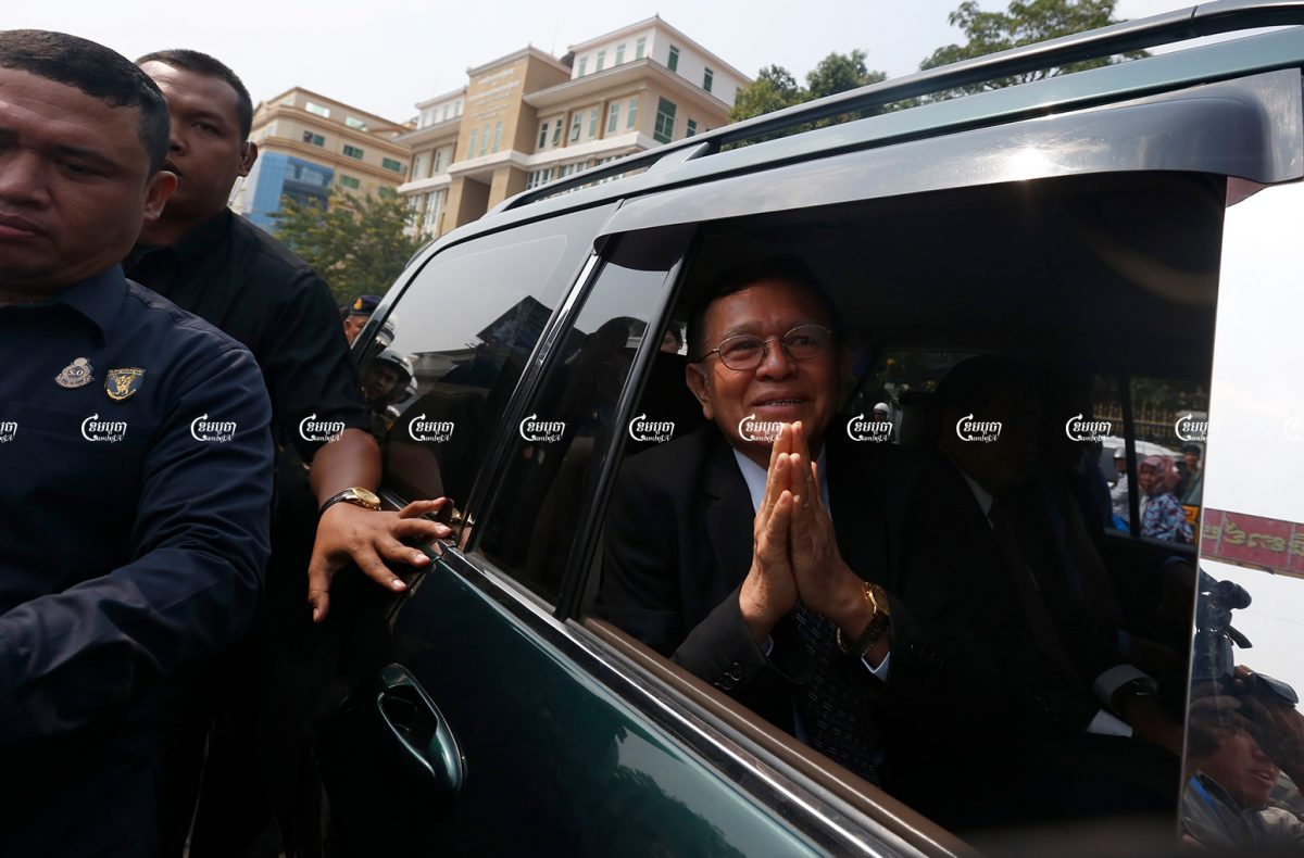 Former opposition leader Kem Sokha greets onlookers as he leaves the Phnom Penh Municipal Court. Picture taken on January 16, 2020. CamboJA/ Pring Samrang