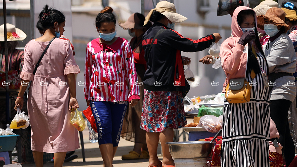 Garment workers buy lunch in front of a factory in Kandal province, picture taken on June 4, 2021. CamboJA/ Pring Samrang